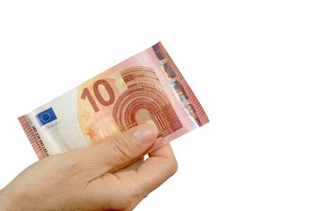 laundered: Hand is holding a ten euro note. Isolated on the white background.