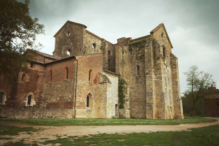 edited photo: Ruins of the Abbey of Saint Galgano near Siena (Tuscany, Italy). Edited as a vintage photo with darken edges.