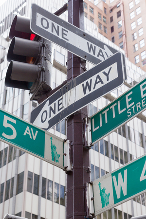 street signs: Street signs for Fifth Avenue and Liitle Brazil street in Manhattan (New York City). Stock Photo