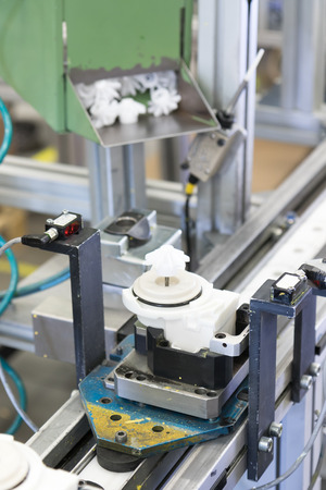 lean machine: View from above on assembly line for the production of plastic components. All potential trademarks are removed. Stock Photo