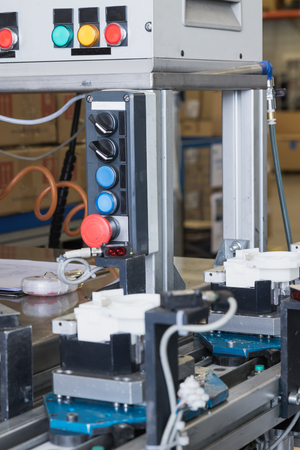 lean machine: Closeup view of the assembly line for the production of plastic components. All potential trademarks are removed. Stock Photo