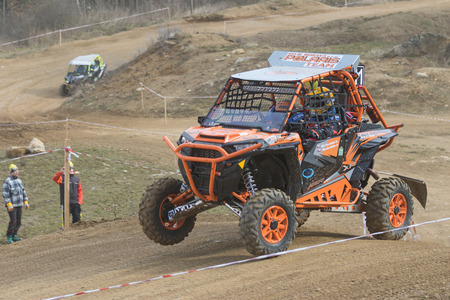 off road: MOHELNICE,  CZECH REPUBLIC - MARCH 19: Special orange off road car is jumping in terrain at  OffROAD Marathon 2016 on March 19, 2016 in Mohelnice, Czech Republic.