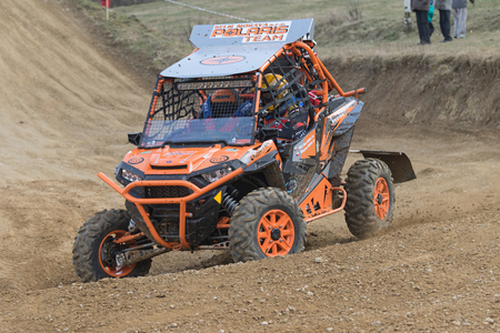 off road: MOHELNICE,  CZECH REPUBLIC - MARCH 19: Special orange off road car in the turn in terrain  at OffROAD Marathon 2016 on March 19, 2016 in Mohelnice, Czech Republic.