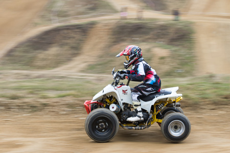 quad: MOHELNICE,  CZECH REPUBLIC - MARCH 19: Dynamic shot of the little boy on quad in the quad race at OffROAD Marathon 2016 on March 19, 2016 in Mohelnice, Czech Republic.