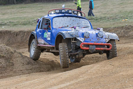 off road: MOHELNICE,  CZECH REPUBLIC - MARCH 19: Special blue off road car is in the turn in terrain  at OffROAD Marathon 2016 on March 19, 2016 in Mohelnice, Czech Republic. Editorial
