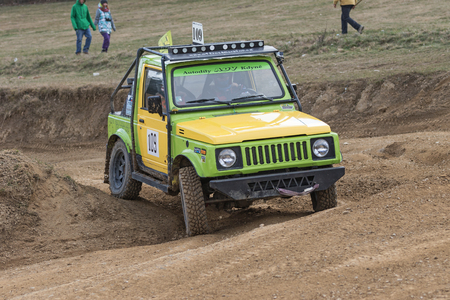off road: MOHELNICE,  CZECH REPUBLIC - MARCH 19: Front view of yellow and green off road car in terrain  at OffROAD Marathon 2016 on March 19, 2016 in Mohelnice, Czech Republic.