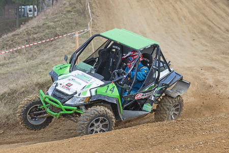 off road: MOHELNICE,  CZECH REPUBLIC - MARCH 19: Green off road car in the turn  at OffROAD Marathon 2016 on March 19, 2016 in Mohelnice, Czech Republic. Editorial