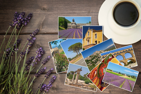 edited photo: Lavender flowers and white cup of coffee are lying on a wooden desk. Photos from Provence are lying between them. Photo is edited as vintage with dark edges. Stock Photo