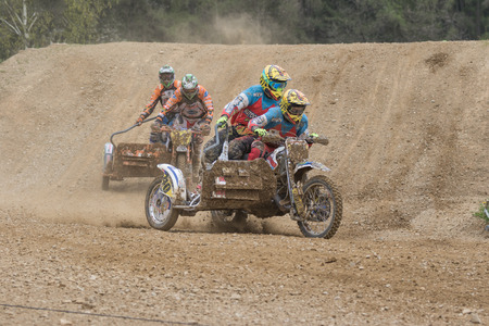 clash: MOHELNICE, CZECH REPUBLIC - APRIL 23. Clash of two crew of sidecars in the Crossracing cup 2016- Sidecars Championship of Czech Republic on April 23. 2016 in Mohelnice. Editorial