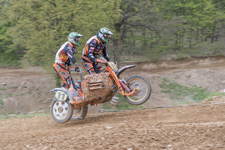 sidecar: MOHELNICE, CZECH REPUBLIC - APRIL 23. Two sidecar racers are falling to the ground  in the Crossracing cup 2016- Sidecars Championship of Czech Republic on April 23. 2016 in Mohelnice.