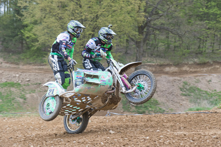 sidecar: MOHELNICE, CZECH REPUBLIC - APRIL 23. Sidecar racers are falling to the ground on one wheel  in the Crossracing cup 2016- Sidecars Championship of Czech Republic on April 23. 2016 in Mohelnice. Editorial