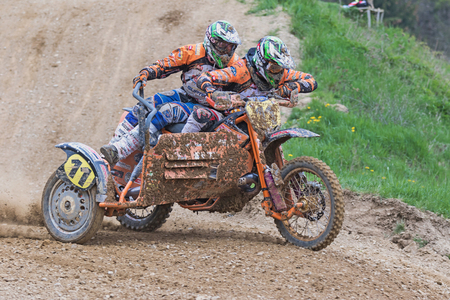 sidecar: MOHELNICE, CZECH REPUBLIC - APRIL 23. Sidecar riders are riding in the turn in the Crossracing cup 2016- Sidecars Championship of Czech Republic on April 23. 2016 in Mohelnice.