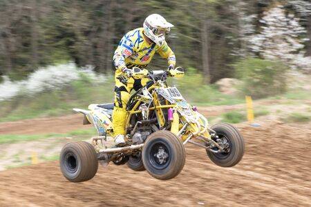 quad: MOHELNICE, CZECH REPUBLIC - APRIL 23. Closeup dynamic shot of quad rider in the Crossracing cup 2016- Quad Championship of Czech Republic on April 23. 2016 in Mohelnice.