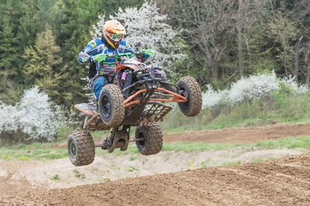 quad: MOHELNICE, CZECH REPUBLIC - APRIL 23. Closeup of quad rider in high jumping  in the Crossracing cup 2016- Quad Championship of Czech Republic on April 23. 2016 in Mohelnice.