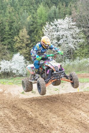 quad: MOHELNICE, CZECH REPUBLIC - APRIL 23. Quad rider is jumping in muddy terrain in the Crossracing cup 2016- Quad Championship of Czech Republic on April 23. 2016 in Mohelnice.