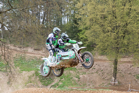 sidecar: MOHELNICE, CZECH REPUBLIC - APRIL 23. Pair of racers jumping a sidecar in the Crossracing cup 2016- Sidecars Championship of Czech Republic on April 23. 2016 in Mohelnice. Editorial