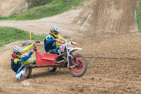 sidecar: MOHELNICE, CZECH REPUBLIC - APRIL 23. Pair of sidecar racers in the turn in the Crossracing cup 2016- Sidecars Championship of Czech Republic on April 23. 2016 in Mohelnice. Editorial