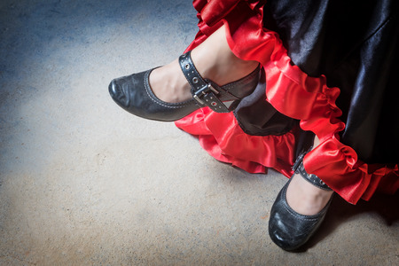 high angle view: High angle view of legs of the Flamenco dancer. The photo has deliberately darkened edges. Horizontally.