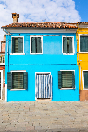 Blue house n Burano Island (Venice, Italy). All potential trademarks are removed.