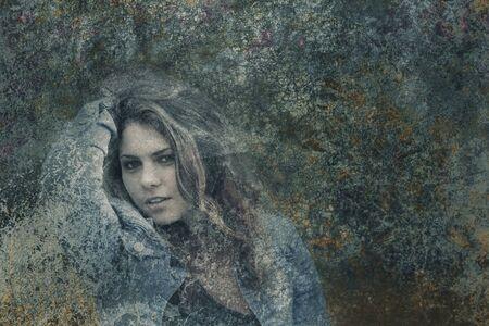 teenage girl: Double exposure of attractive teenage girl hiding behind dark grunge texture.