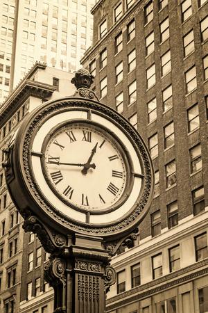 fifth avenue: Manhattan Sidewalk Clock at 5th Avenue in New York City (USA). Edited as a vintage photo with dark edges.