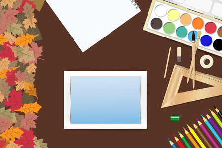 School supplies and a tablet with empty screen ready for your text are lying on a brown wooden table. The edge forms colorful autumn leaves. Ilustração