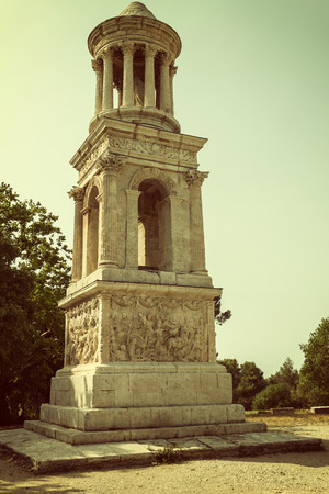 edited photo: The Mausoleum of the Julii at Glanum near Saint-Rémy de Provence (France). Edited as a vintage photo with dark edges.