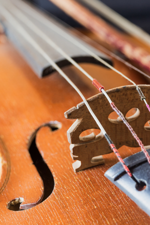 Closeup view of the used old violin. Edited as a vintage photo.  All potential trademarks are removed. Stock Photo