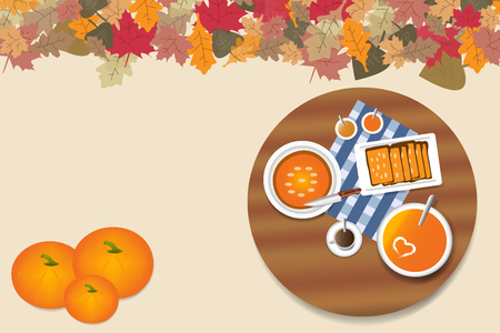 Top view on the rounded wooden table autumn pumpkin menu. The top edge of the is ribbed with colorful autumnal leaves. Free place is ready for your text.