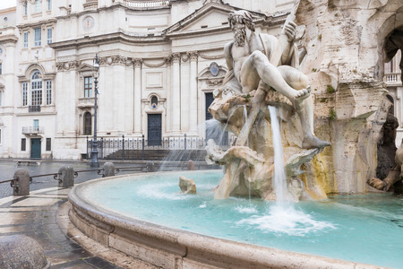 Fountain of the Four Rivers in the Piazza Navona (Navona Square) in Rome with SantAgnese in Agone church in the background. Italy Stock Photo