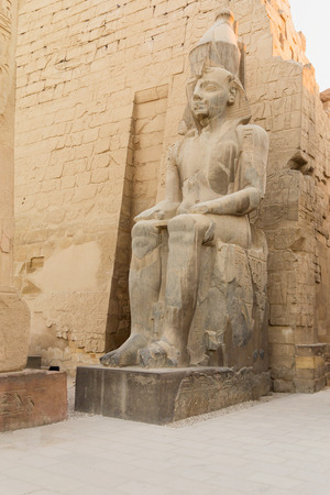 Statue of the King Ramses II at the entrance to Luxor Temple (Egypt). Vertically.