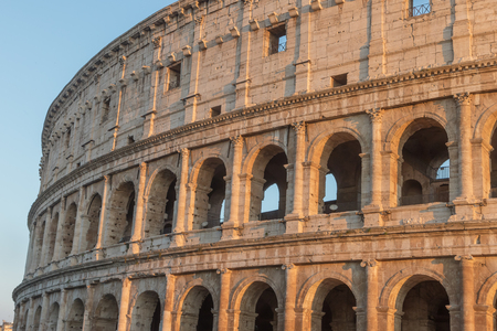 The arcs of Colosseum in sunset light. Rome Italy. Horizontally Reklamní fotografie