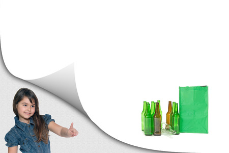 Little girl is showing a pile of sorted glass waste with ready empty bag on the white background ready for your text.  All potential trademarks are removed. Standard-Bild - 122662845