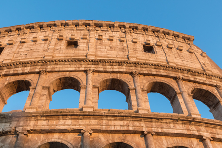 Front view of the arcs of Colosseum in sunset light. Rome Italy. Horizontally