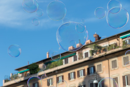 Colorful soap bubbles are flying over buildings on Navona Square in Rome. Italy. Standard-Bild - 122662846