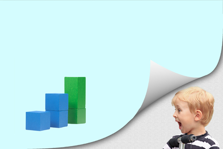 Surprised blond boy standing in an exposed corner is looking at blank page with a graph of blue wooden cubes with the highest grade in green color. Imagens - 124951594