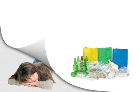 Blank page with curl effect and sad little girl lying in an exposed corner looking at the camera. Blank page with a pile of sorted waste with ready colored bags is ready for your text.  All potential trademarks are removed.