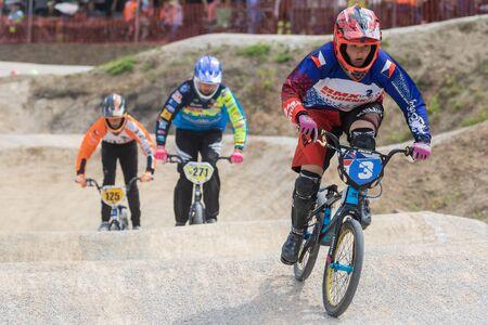 ZABREH, CZECH REPUBLIC - JUNE 1, 2019: The three young racers on the bike at The Olomouc Region Championship BMX in new bi-cross area in Zabreh.