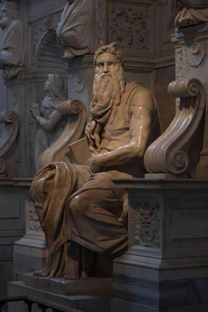 Rome, Italy – 9 May 2018: The famous colossal statue of Moses carved by Michelangelo Buonarroti  in 1513 is located in San Pietro in Vincoli church in Rome not far from the Colosseum.