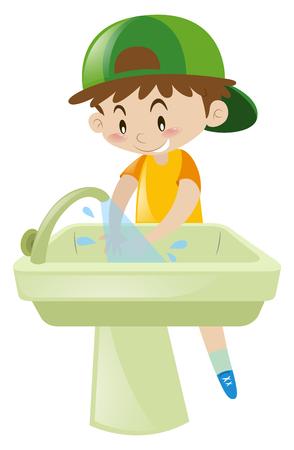 シンクの図に手を洗っている少年