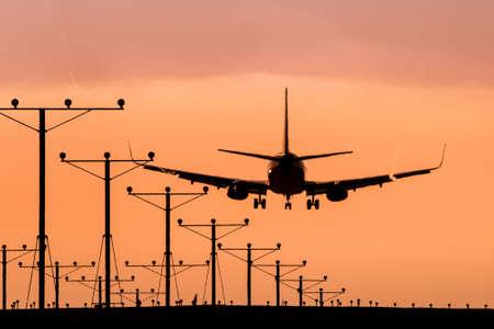 Jet Landing at Sunset photo