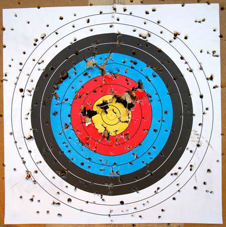 bullet hole: Shot Up Target with Bullseye
