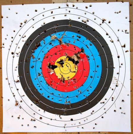 Shot Up Target with Bullseye