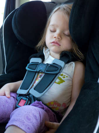 buckled: Toddler in Car Seat Stock Photo