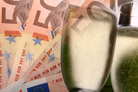 Five fifty euro notes, 2 champagne flutes collaged suggesting prize winner. photo