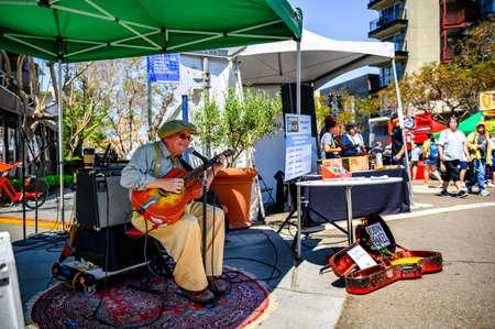 San Diego, CA. United States - 04-27-2019: Mission Fed ArtWalk in Little Italy - Musician: Robin Henkel