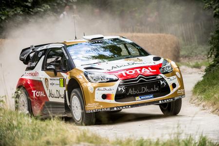 west sussex: West Sussex, UK - June 29, 2014: Rally car slides around corner on gravel track