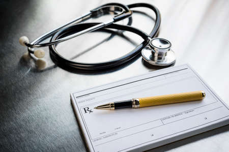 a pen and stethoscope on a prescription pad Stock Photo
