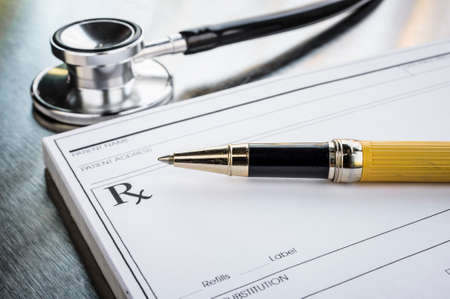 a prescription form and stethoscope photo