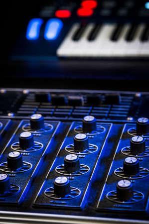 mixing board and synthesizer in a studio Stock Photo